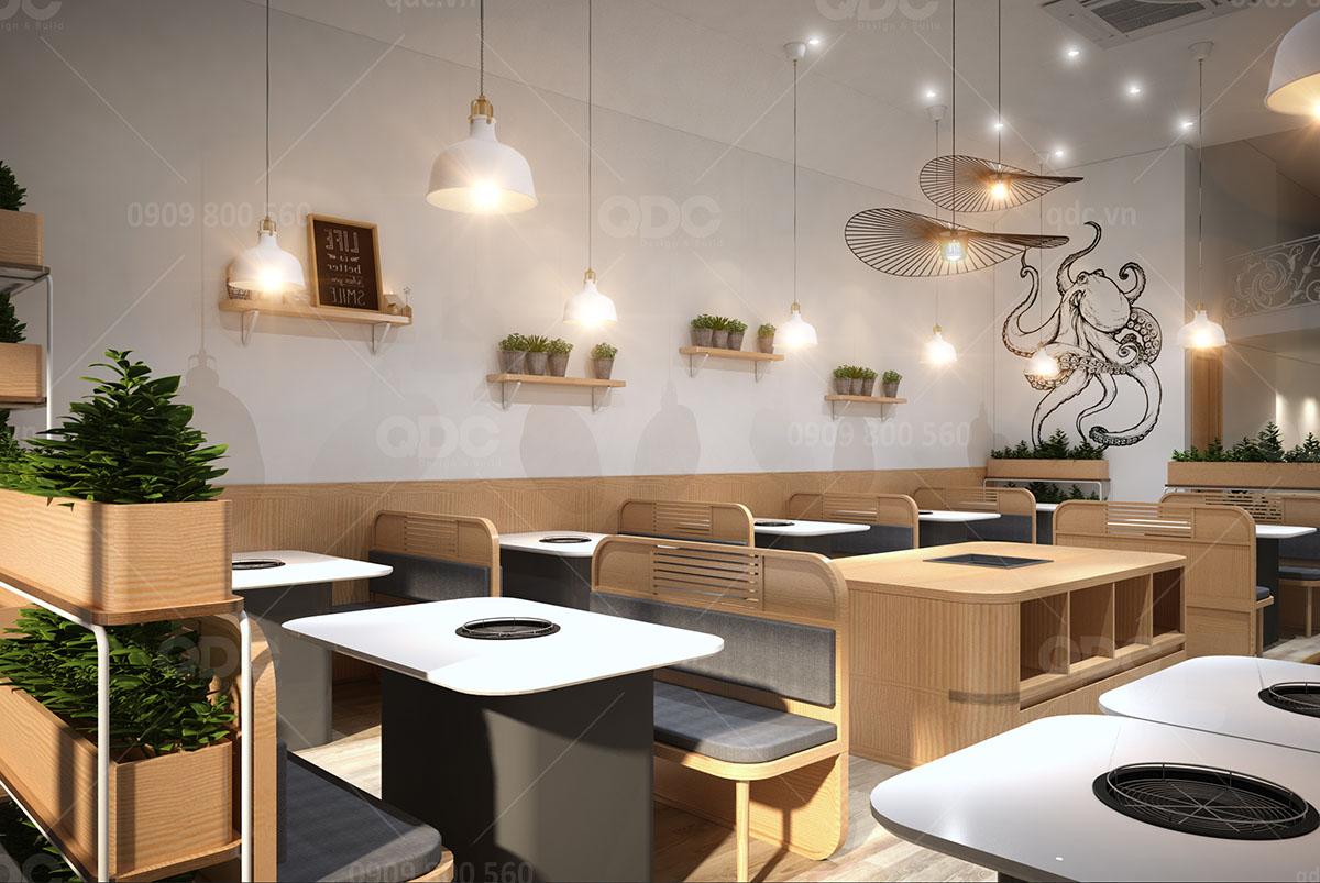Ánh sáng vàng khiến không gian nhà hàng BBQ sáng hẳn
